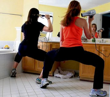 Jenny Hein, right, and Vicky Hallett workout while styling their hair. Image: Susan Biddle