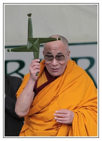 His Holiness the Dalai Lama being presented with a St. Brigid Cross on visit to Kildare, Ireland in 2011.
